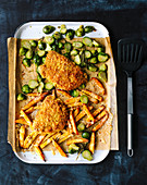 Escalopes with Brussels sprouts and Gruyère chips