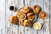 Homemade puff pastry buns, cinnamon rolls and croissant served with jam, butter as breakfast