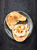 Oriental date and bacon dip with naan bread