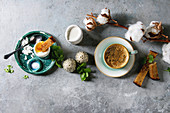 Breakfast with cup of coffee and soft boiled egg, served with toasted bread