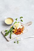 Poached eggs on sweet potatoe rosti with sauce hollandaise