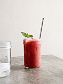 A watermelon and mint freezy with raspberries, dates and honey