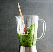 Pureed smoothie ingredients in a blender