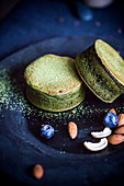 Matcha pancakes with nuts, almonds and blueberries on a dish