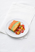 Three-colored vegetable terrine with tomato salad