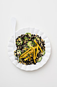 Black rice salad with red lentils, zucchini and peppers