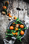 Mandarins and basket on table