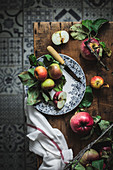 Plate with apples and knife on wooden rustic table