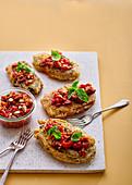 Herb-crusted aubergine steaks with chunky romesco salsa