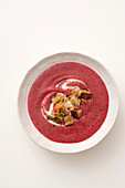 Cream of beetroot and potato with orange zest and croutons