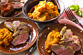 Rare roasted duck breast with mashed sweet potatoes