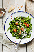 Spinach pasta with tomato, parmesan and toasted almonds