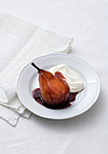 Red wine pears in barolo with whipped cream