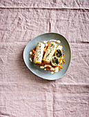 Vitamin-rich kale strudel with sheep's cheese and carrot strips