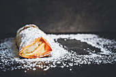 Filo pastry apple strudel with almonds and rum-soaked raisins