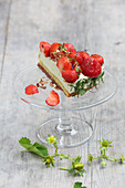 A piece of basil and strawberry cake