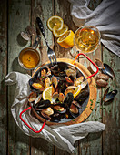 A pan of mussels with lemon slices