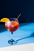 Italian spritz: Campari, white wine and soda water with orange slices and green olive
