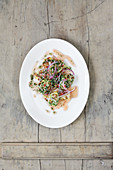 Dumpling salad with red onions