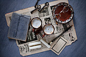 Old newspaper, address book, coffee cups, candles and key