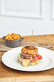 Dumpling burgers with beef, tomato and cucumber