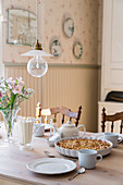 Cake on set table in country-house-style dining room