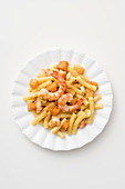 Macaroni with pumpkin and prawns in a curry sauce