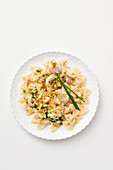 Farfalle with scallops in a herb and champagne sauce