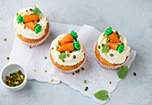 Decorated cream cheese cupcakes with pistachios