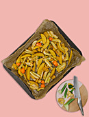 Marinated vegetables on a baking tray