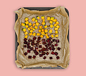 Diced beetroot and pumpkin on a baking tray
