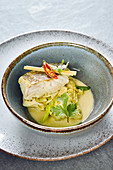 Cod with curry coleslaw and coconut milk