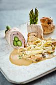 Stuffed asparagus and escalope rolls with porcini mushroom tagliatelle