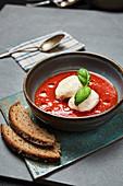 Salsiccia and tomato soup with quark dumplings