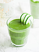 Green smoothie with cucumber slices