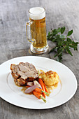 Pork roast with a potato dumpling and carrots