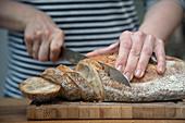 Fresh bread being sliced