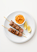 Beef steak skewers with vegetable pesto