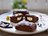 Vegan brownies with vanilla filling and chocolate ganache