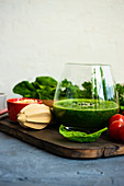 Green smoothie of apple, baby spinacj, cucumber, chia seeds on concrete background