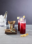 Spelt and seed crackers with cheese and cocoa nibs with red wine cocktails