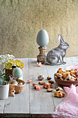 Almond biscuits on a wooden table decorated for Easter