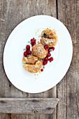 Sweet potato dumplings with cinnamon crumbs