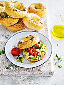 Poppy Seed Bagels with vegetable and feta