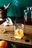 Old fashioned drink with smoked rosemary