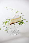 A piece of woodruff cake on a cake stand