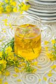 Rape seed oil with rape seed flowers