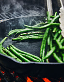 Green beans being grilled