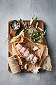 Lamb with kitchen twine, garlic, rosemary and spices
