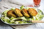 Vegan millet and potato fritters